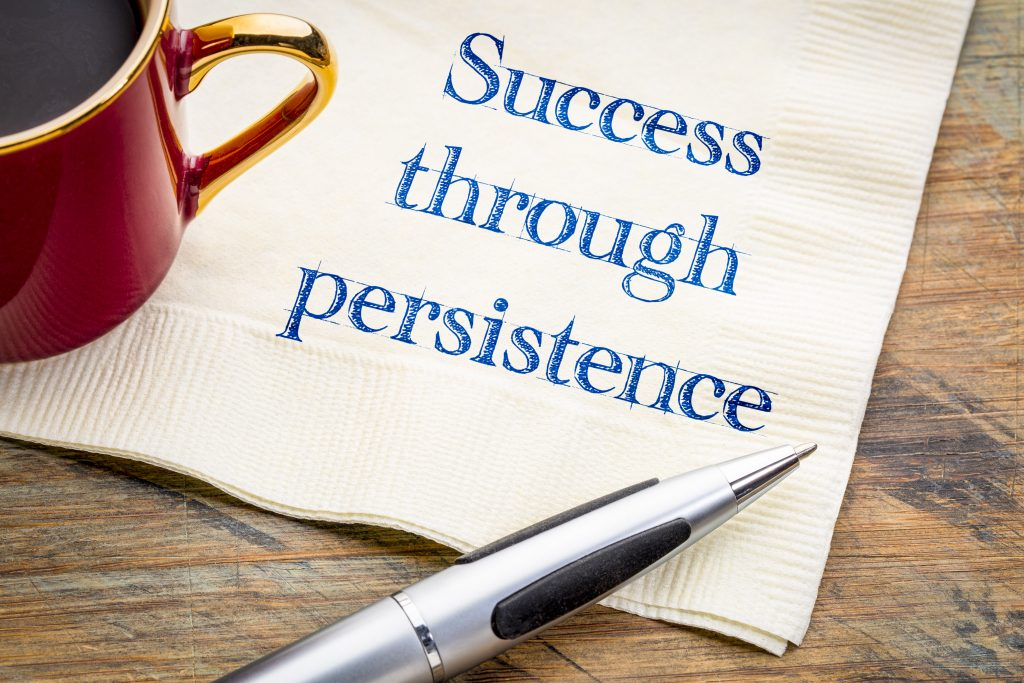 Success through persistence written on a napkin